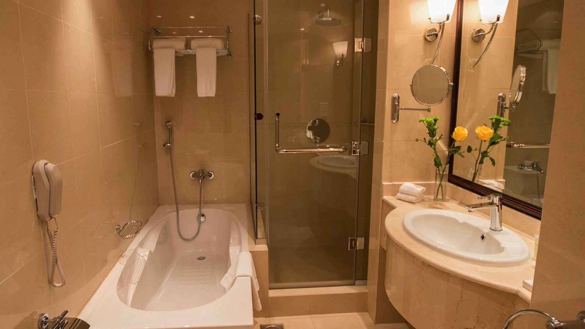 Bathroom Bath with shower at Strato Hotel by Warwick
