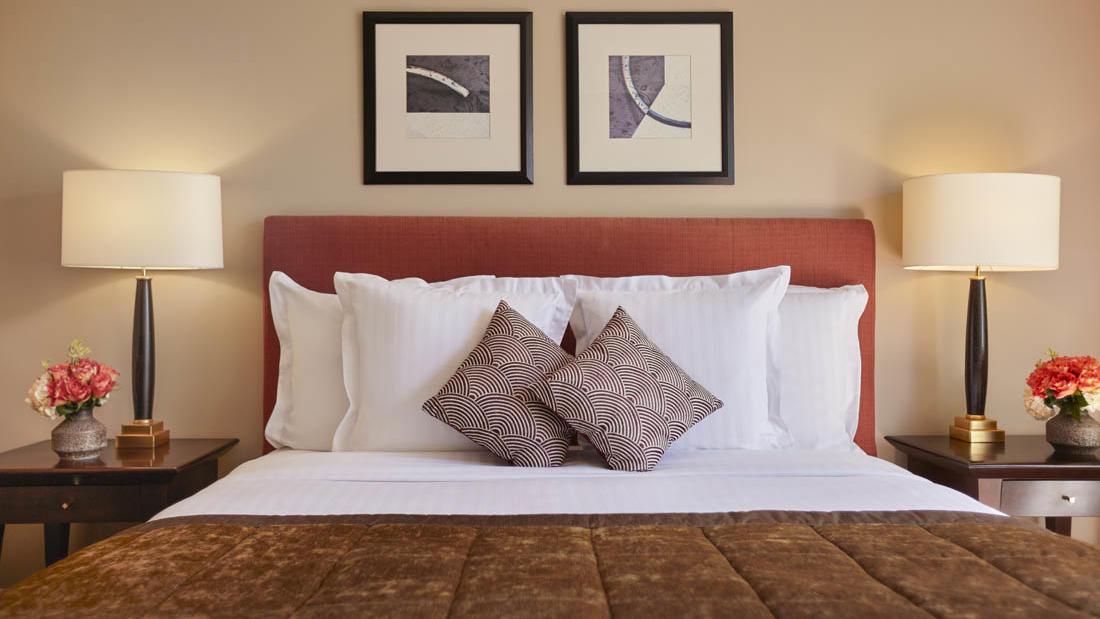 Deluxe Room bed at Warwick Paris