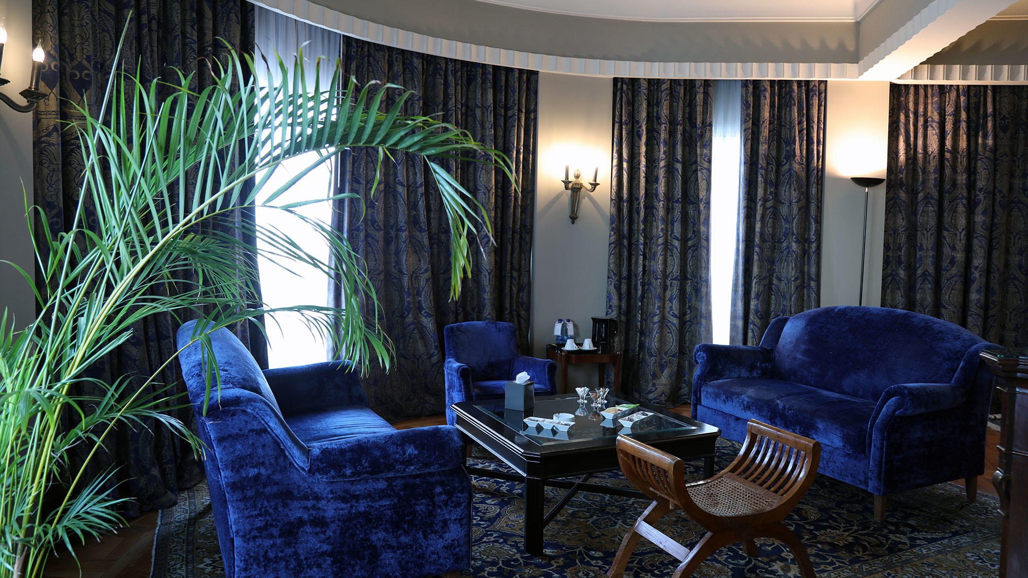 Executive Suite Living Room with blue seats