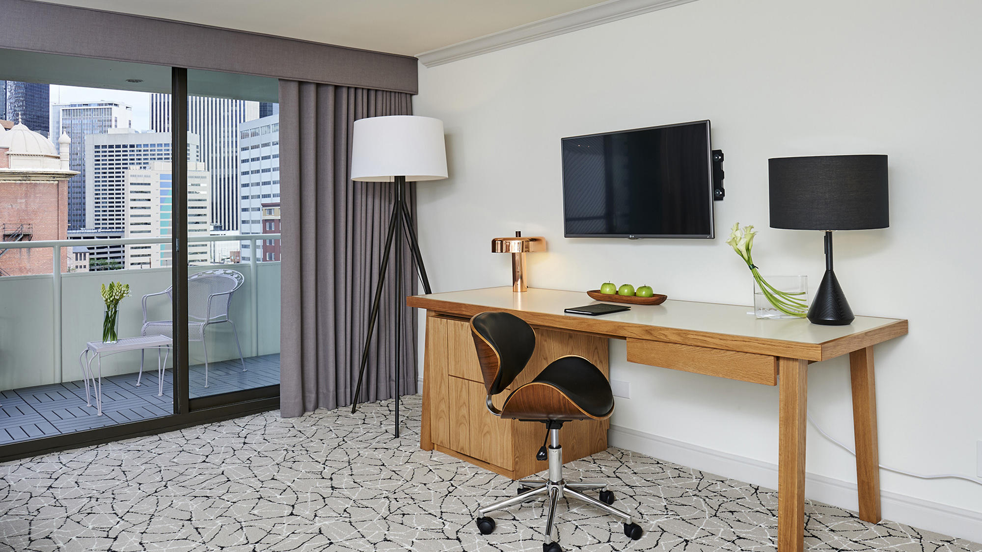 Inroom Deluxe desk and balcony at Warwick Denver