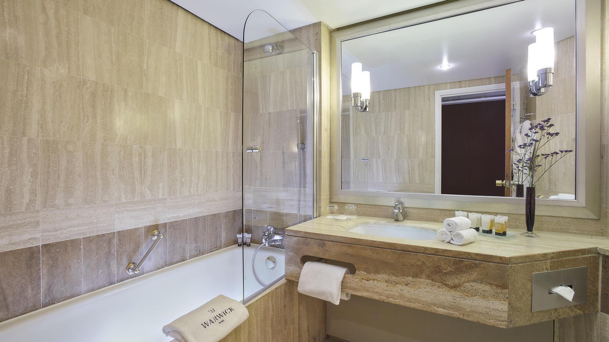 Bathroom with Mirror reflection at Warwick Paris