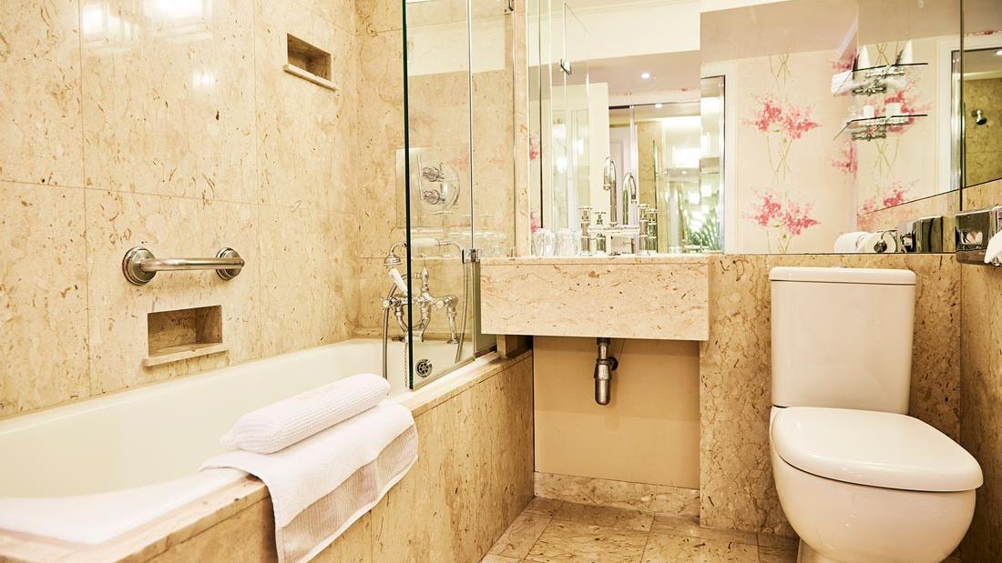 Junior Suite Bathroom at The Capital by Warwick
