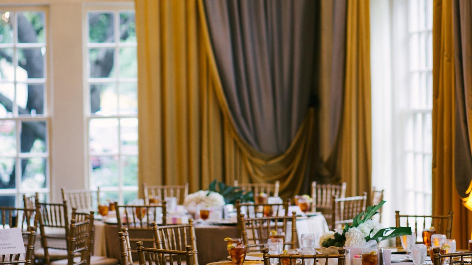 Ballroom with chandelier at Warwick Melrose Dallas
