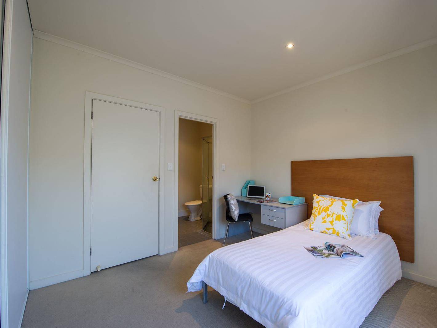 Student Living Edge Apartments – Gray Street Building - Typical bedroom with single bed, study desk & chair, built in wardrobe & with ensuite
