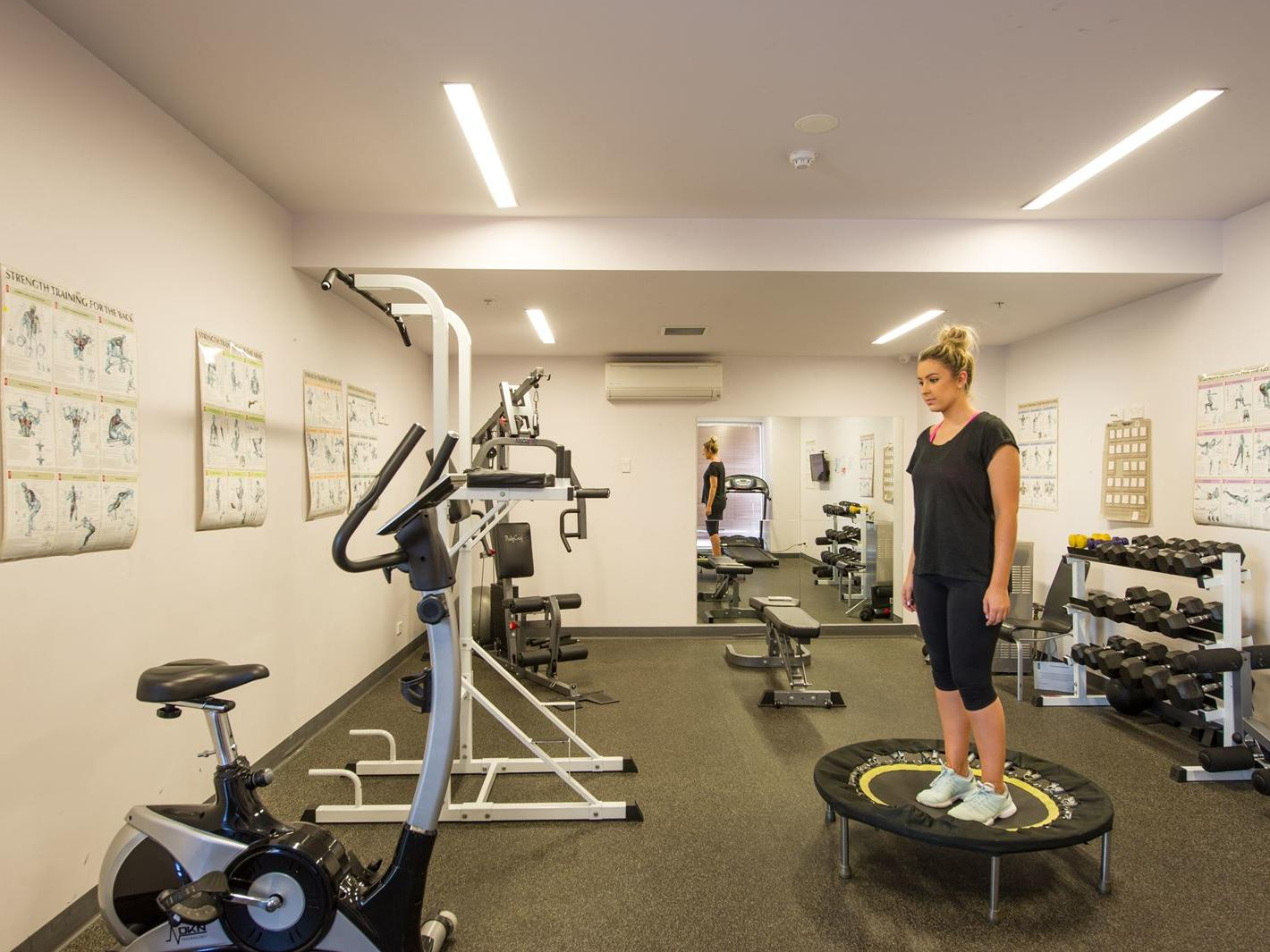 Spacious gym located on the ground floor available for all residents to use - additional fee applies