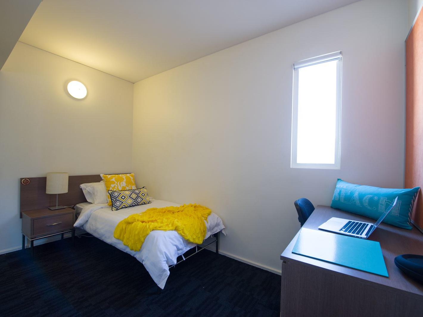 Student Living East West_Adelaide bedroom featuring study desk, chair, single bed & wardrobe