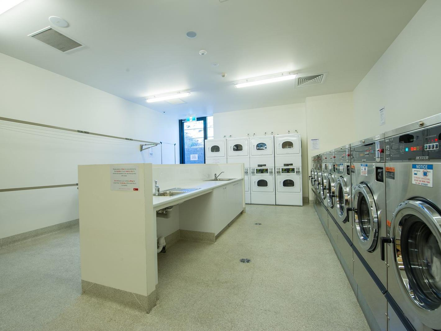 The Laundry is equipped with washing machines, dryers, ironing board, sink & clothes lines