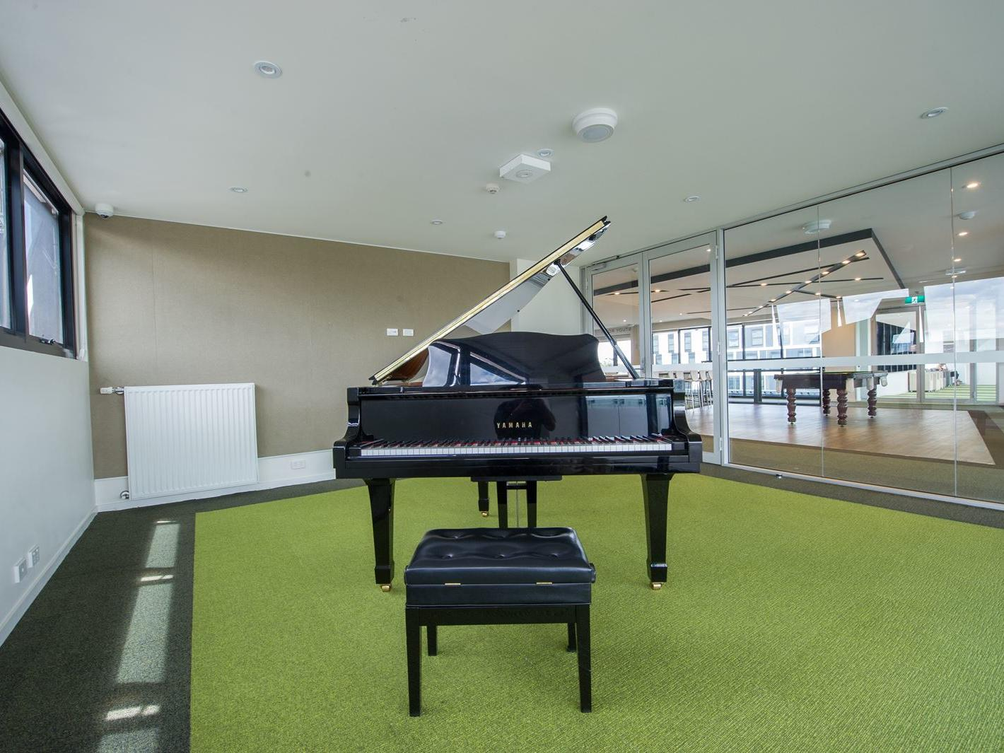 You can practice your piano skills in our very own music room!