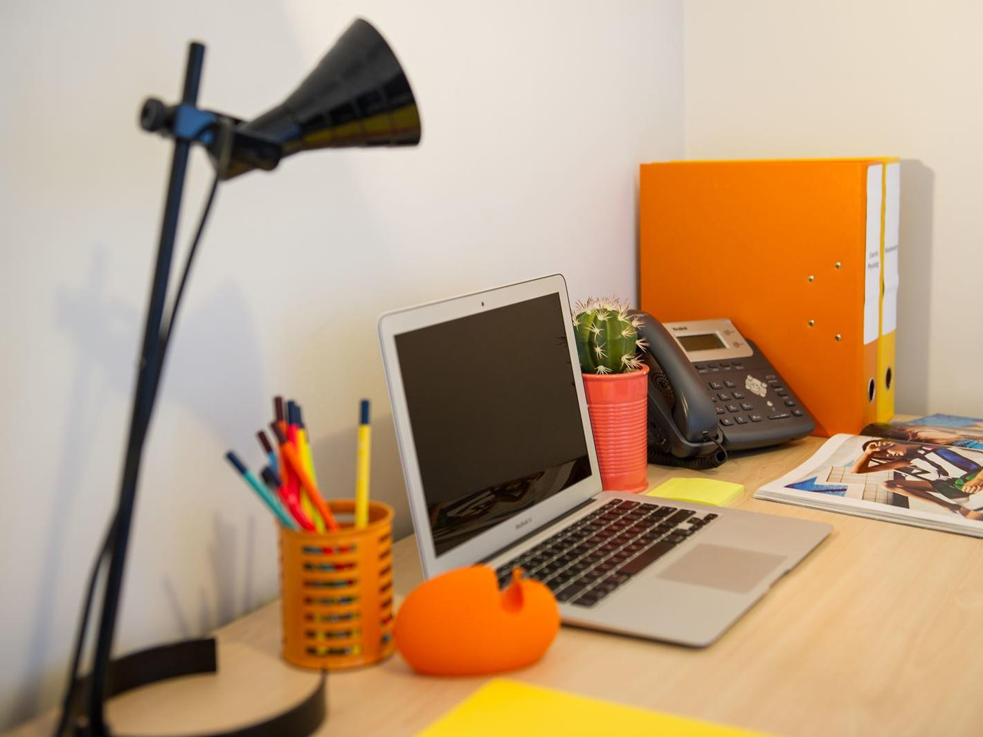 Each apartment includes a large study desk with chair