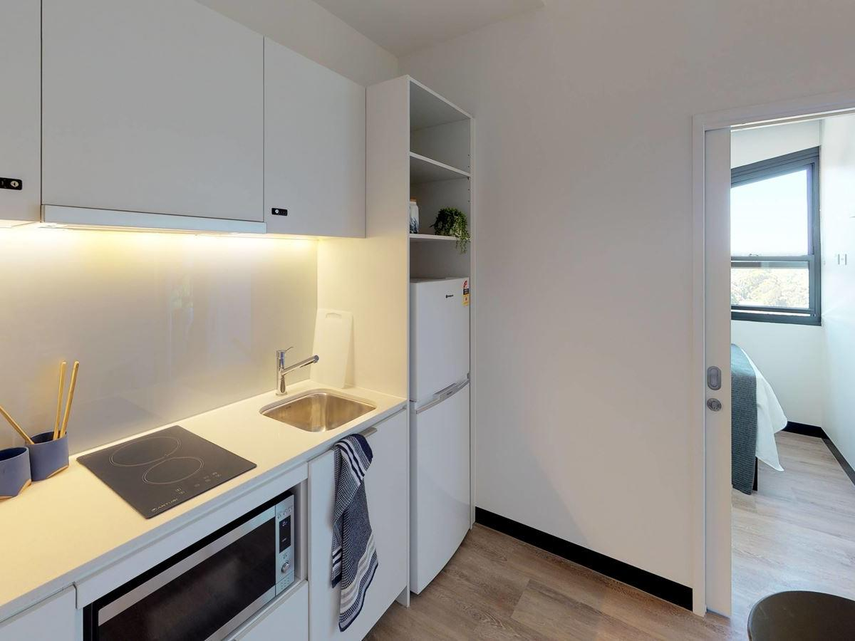 303-royal-parade-studio-twin-kitchen-wide