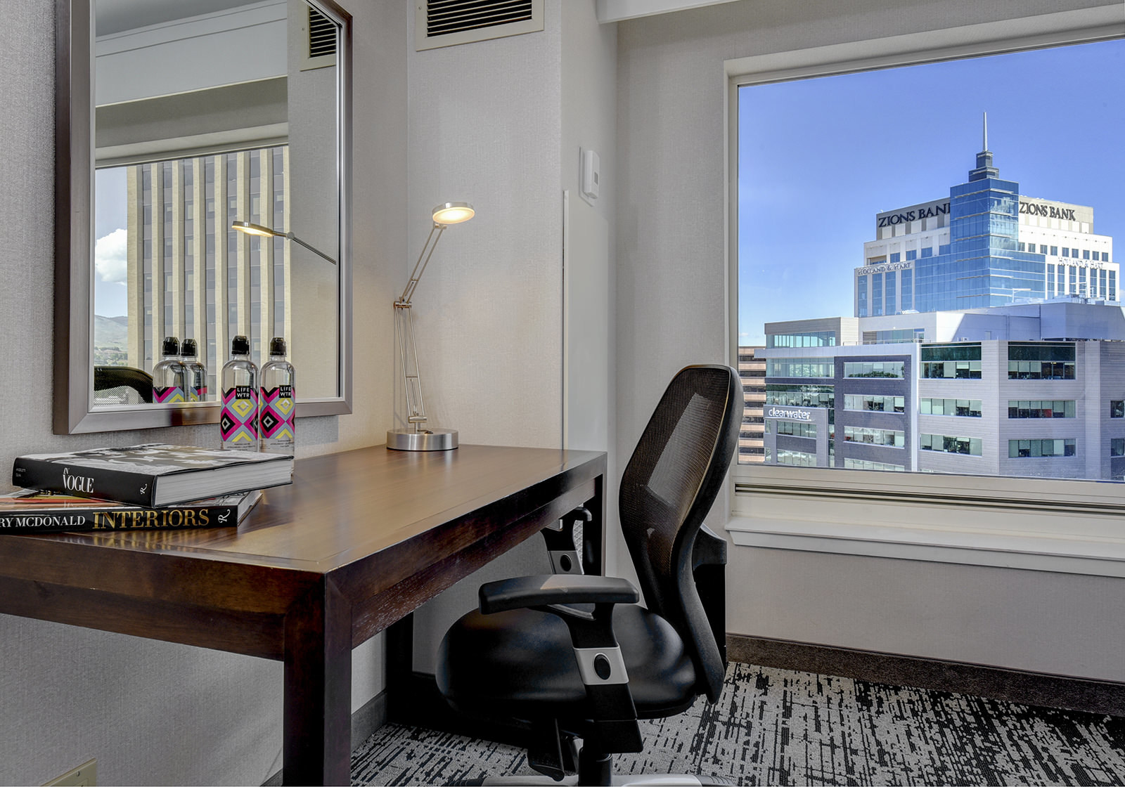 a chair and desk in a hotel room