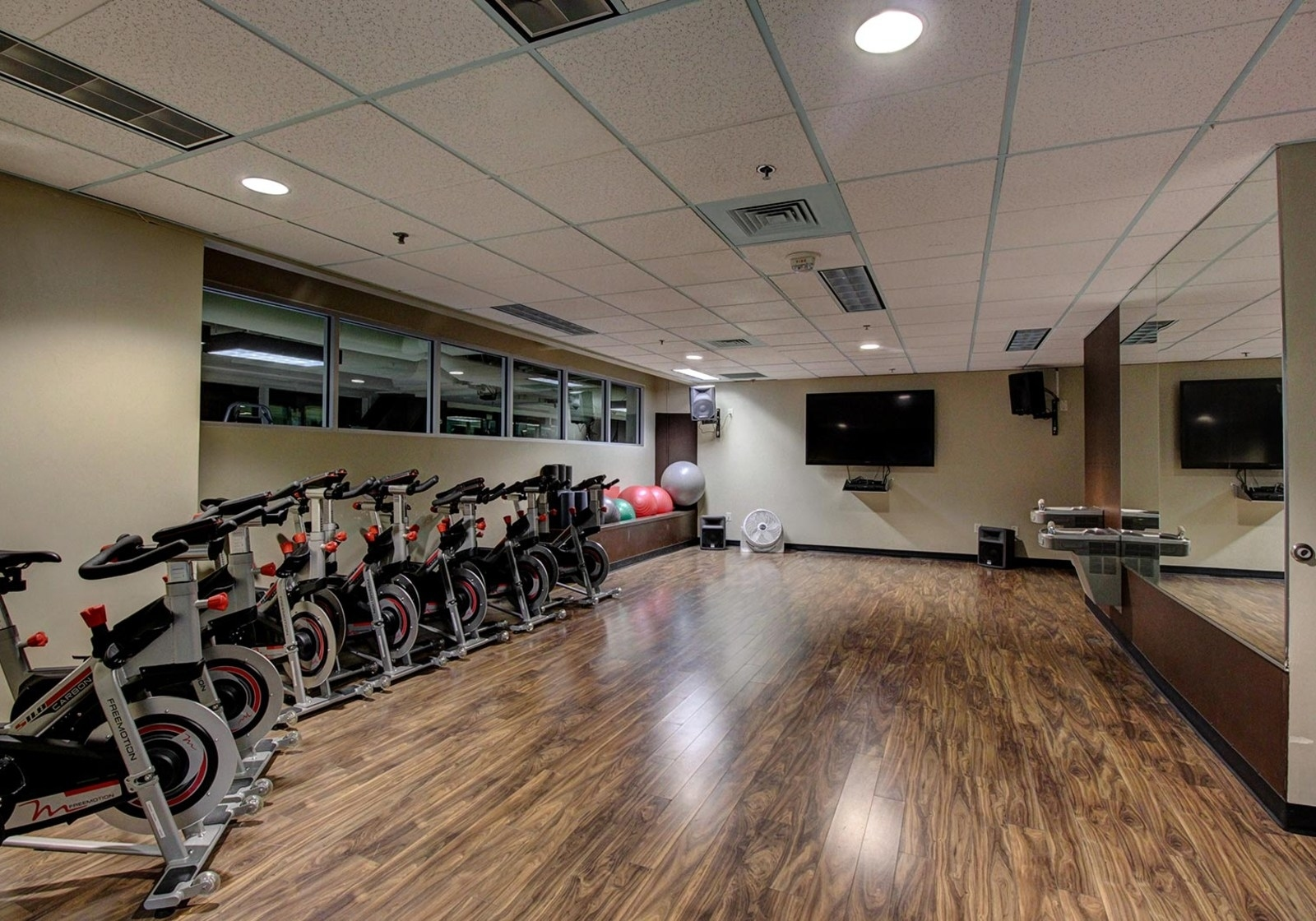 a row of indoor exercise bikes