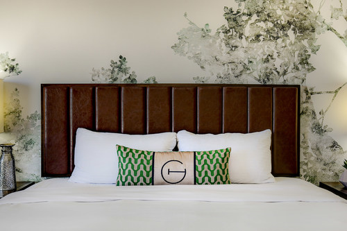 Grove pillow on a king bed