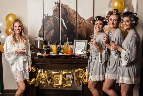 four women celebrating with drinks