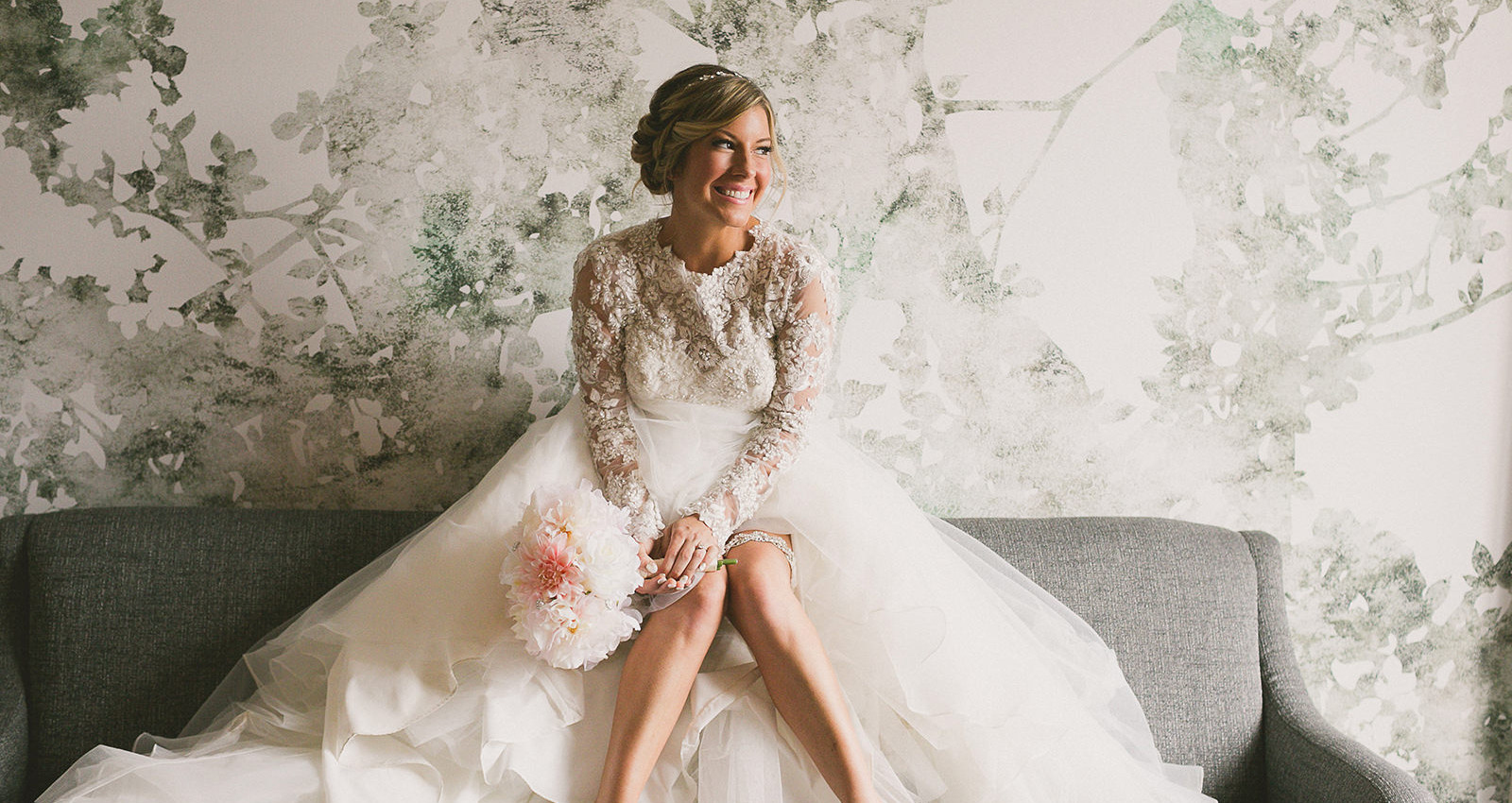 a bride sitting on a couch smiling