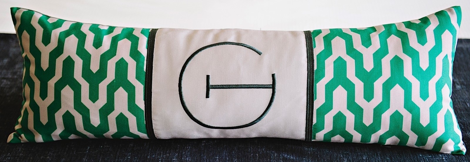 a pillow with an embroidered letter