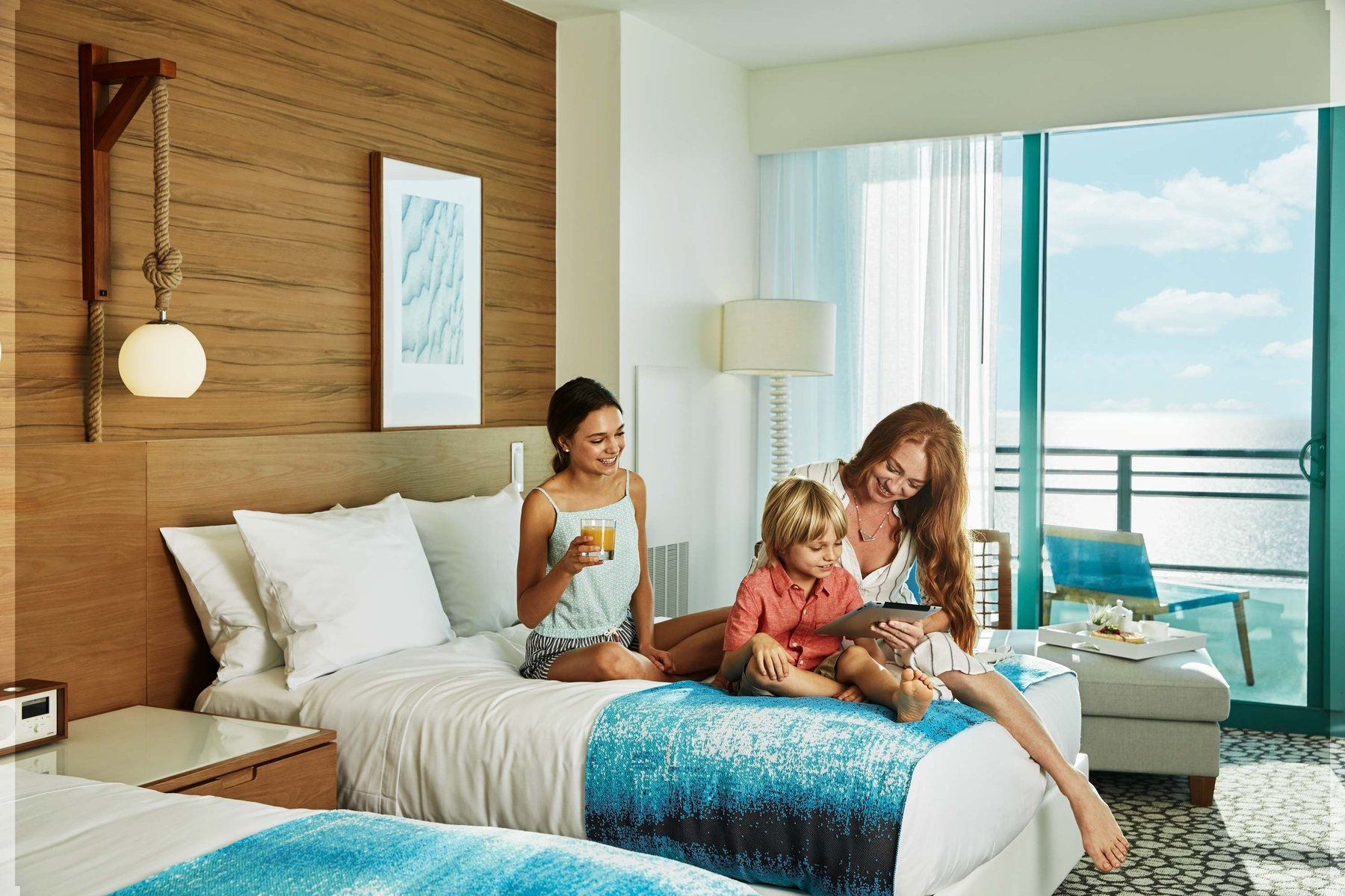 Mom with Kids in Double bedroom with Balcony