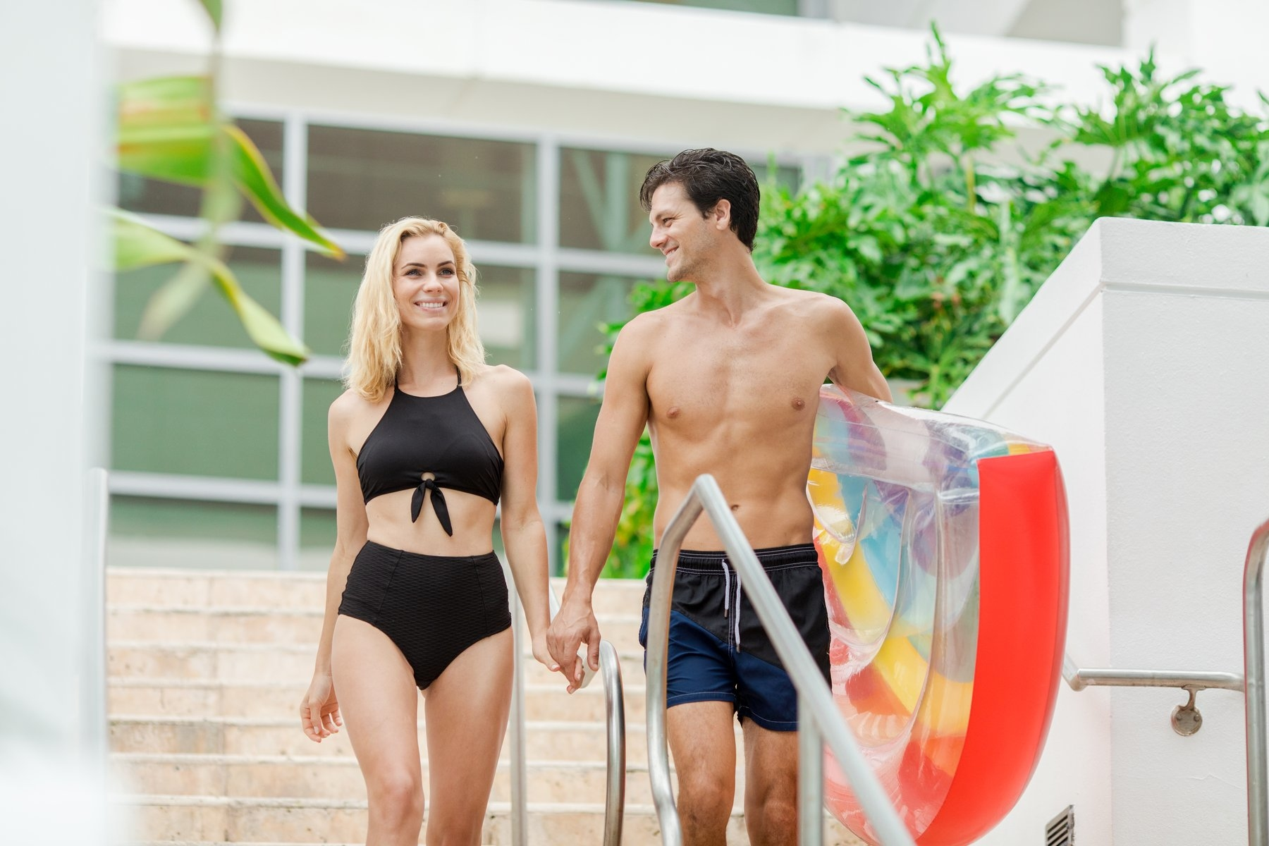 Couple heading to the Pool holding hands