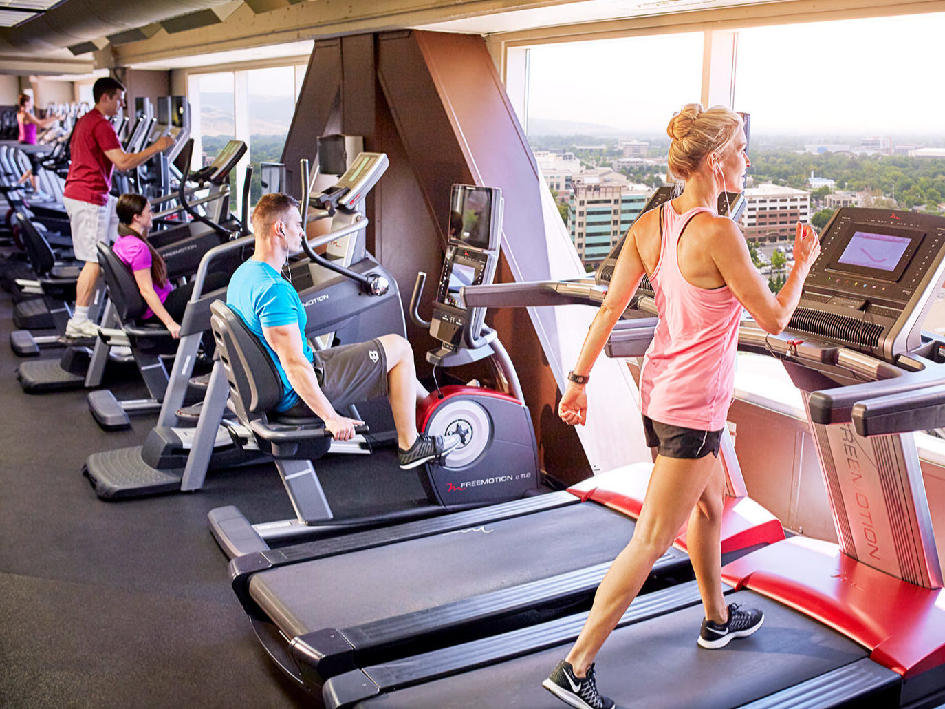 woman working out on a treadmill at the Grove Fitness Club and Spa