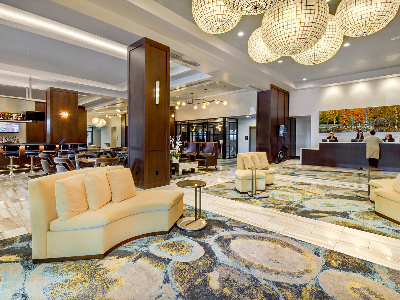 a spacious hotel lobby with seating