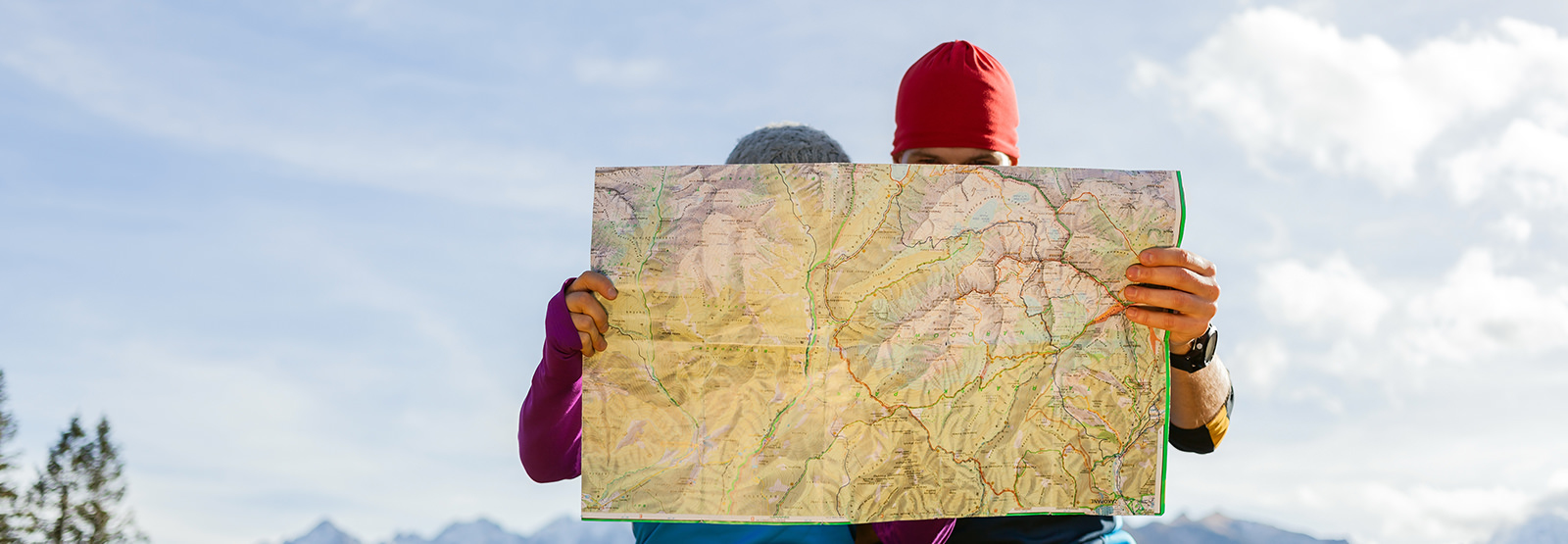 two people holding up a map