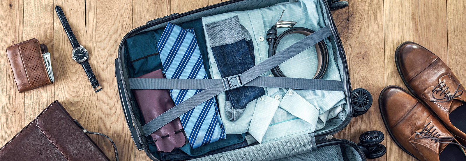 a neatly packed travel bag with business attire