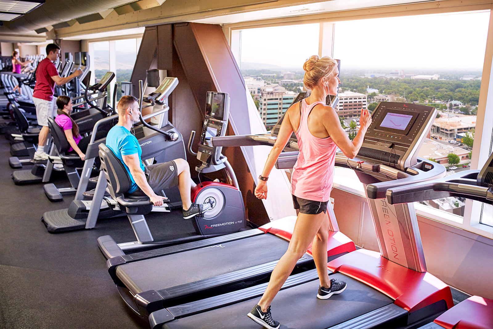people working out on cardio machines at the Grove Fitness Club & Spa