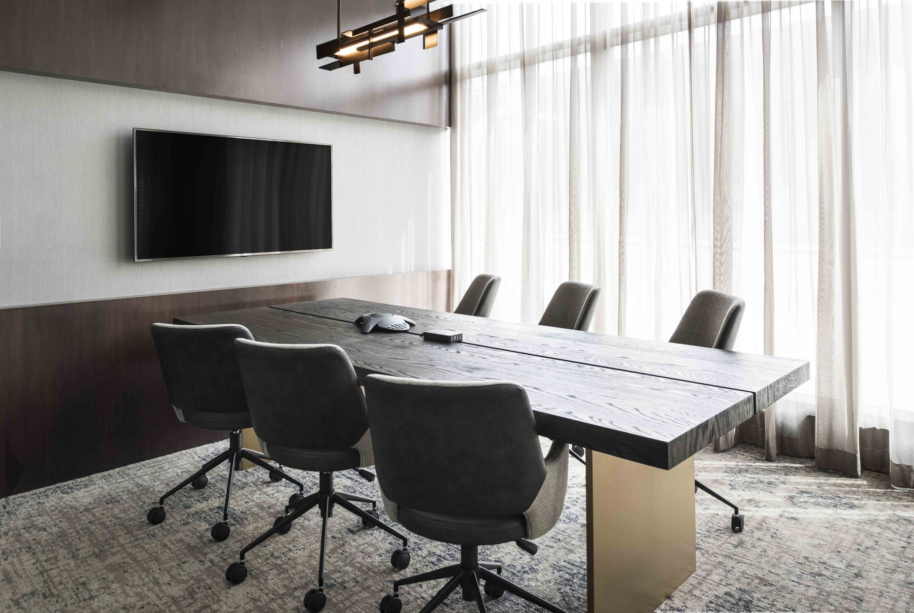 Conference table with chairs and wall mounted TV