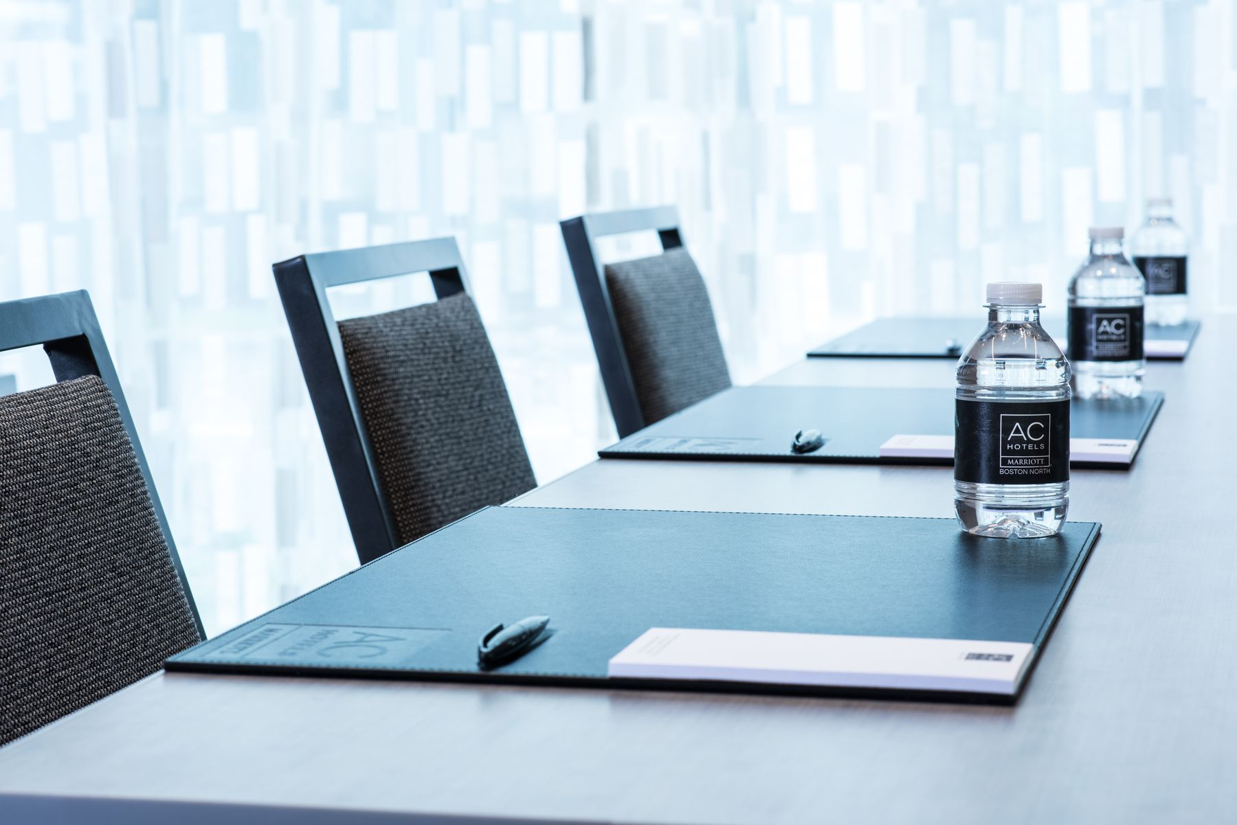 Conference table set with notepad and water bottle