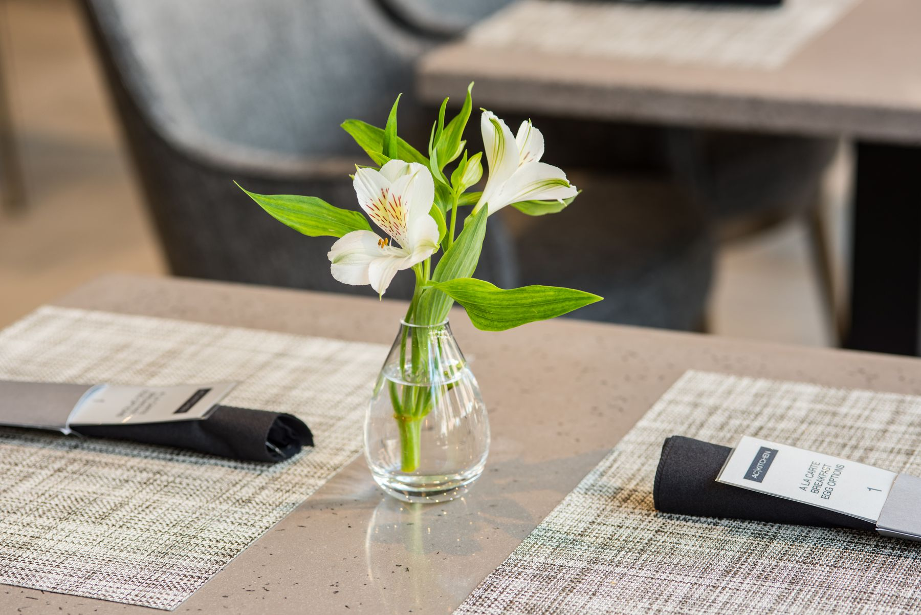Small vase of flowers on table