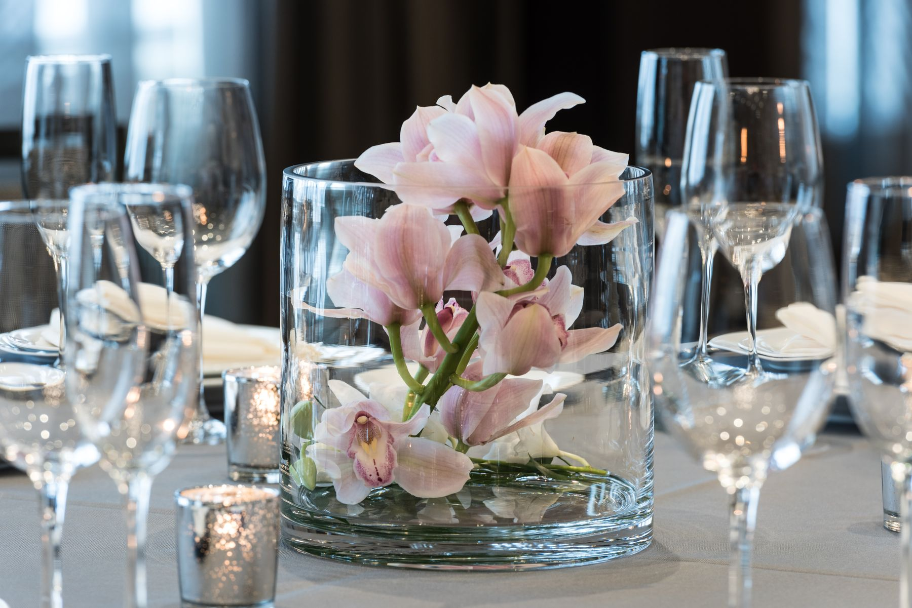 Floral centerpiece and wine glasses