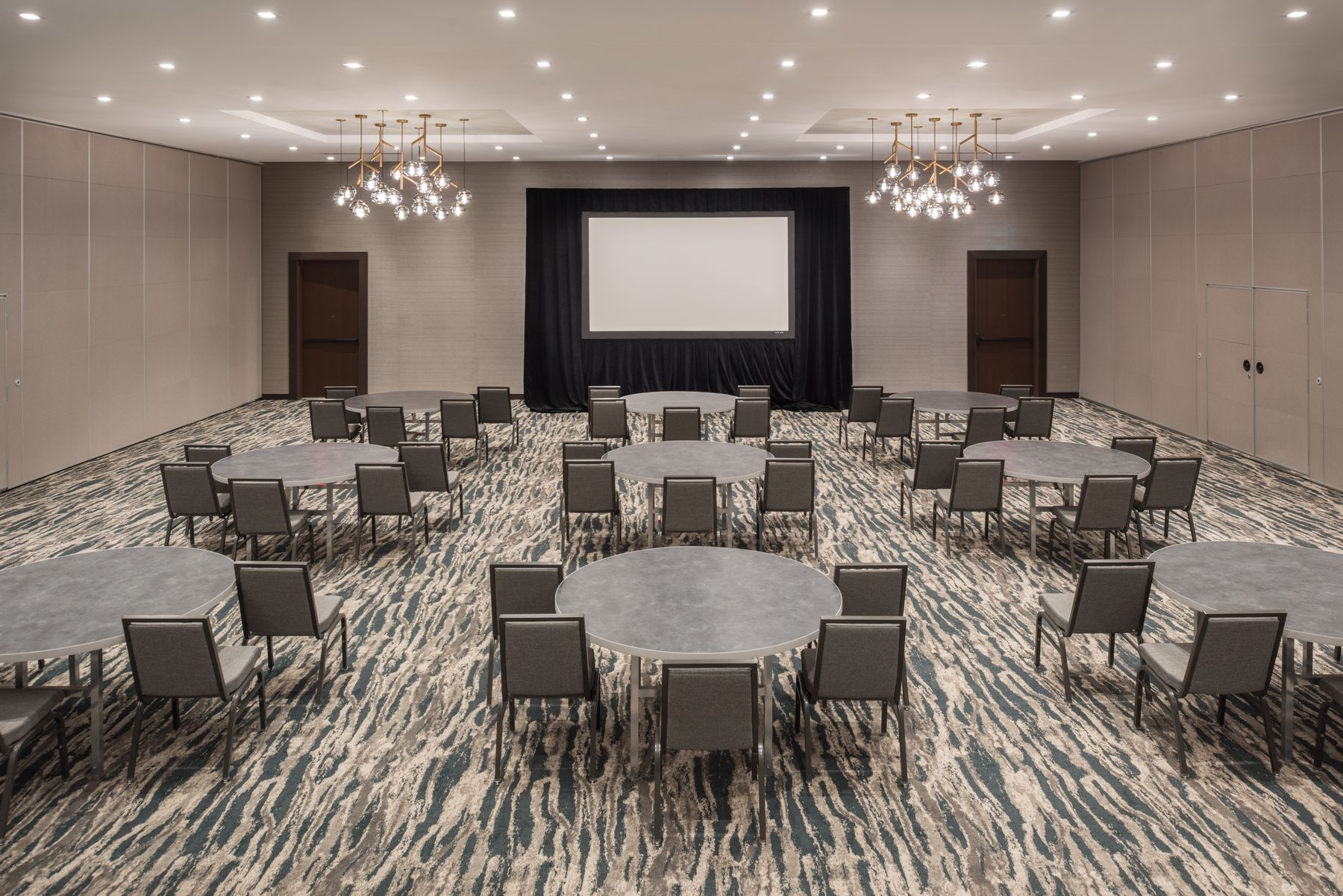 Meeting space set with banquet rounds