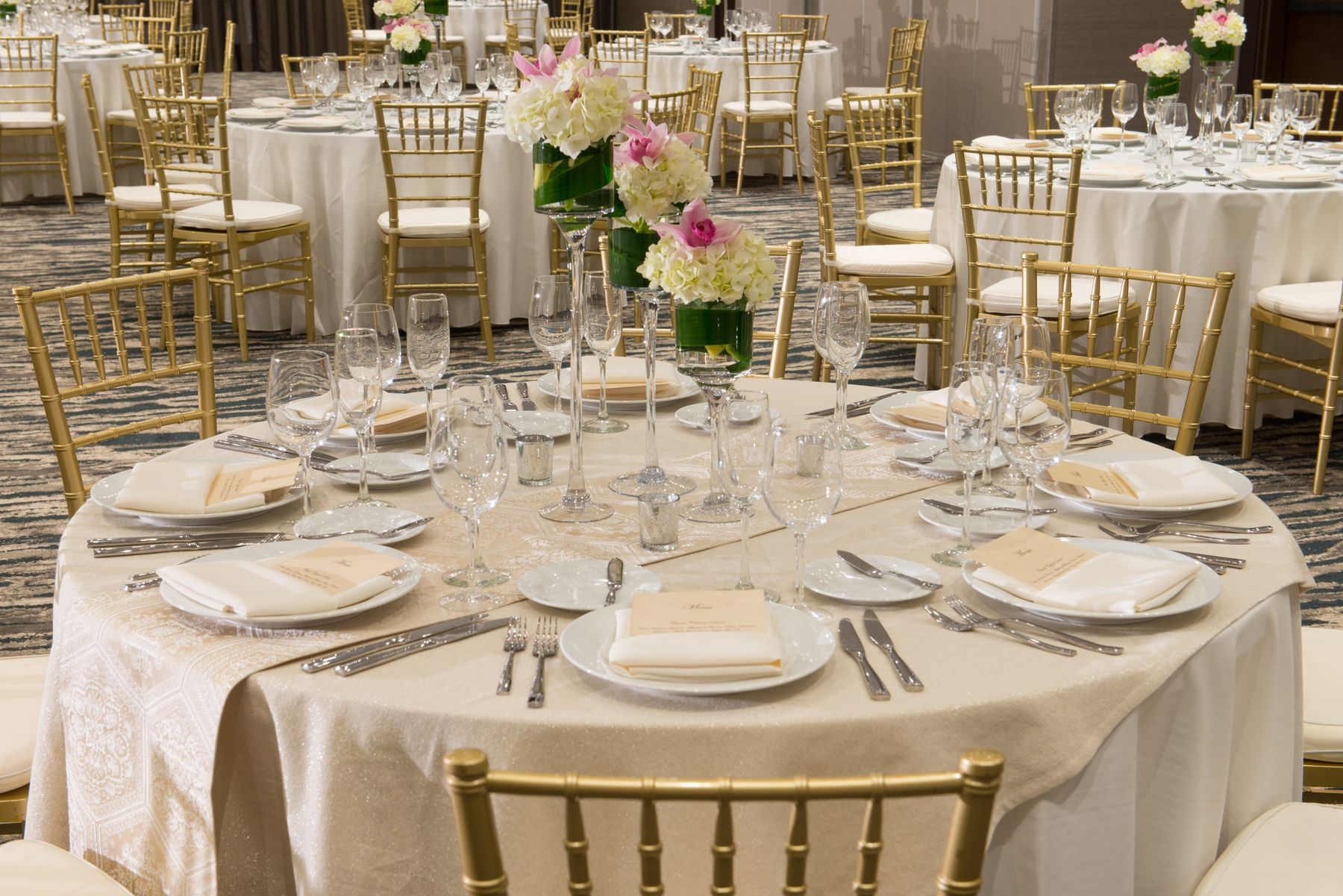 Banquet rounds set with floral centerpieces