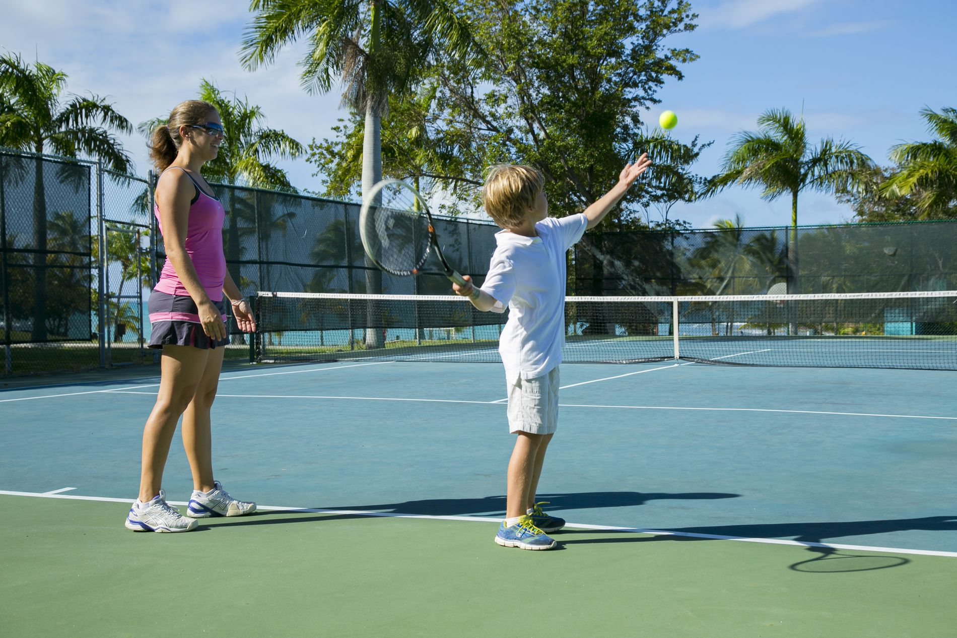 Mom & son playing tennis