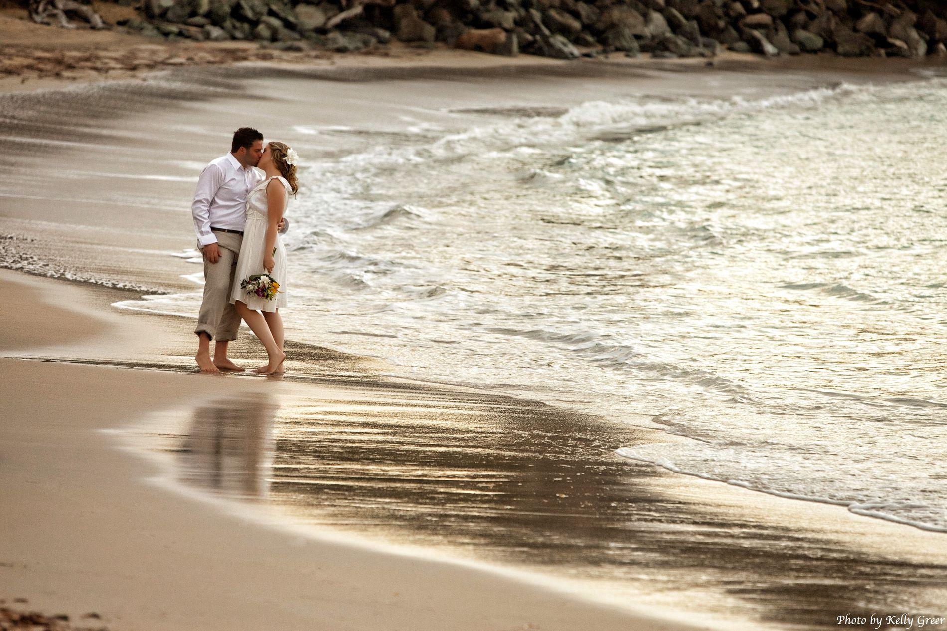 Wedding couple kissing on Whistle Beach