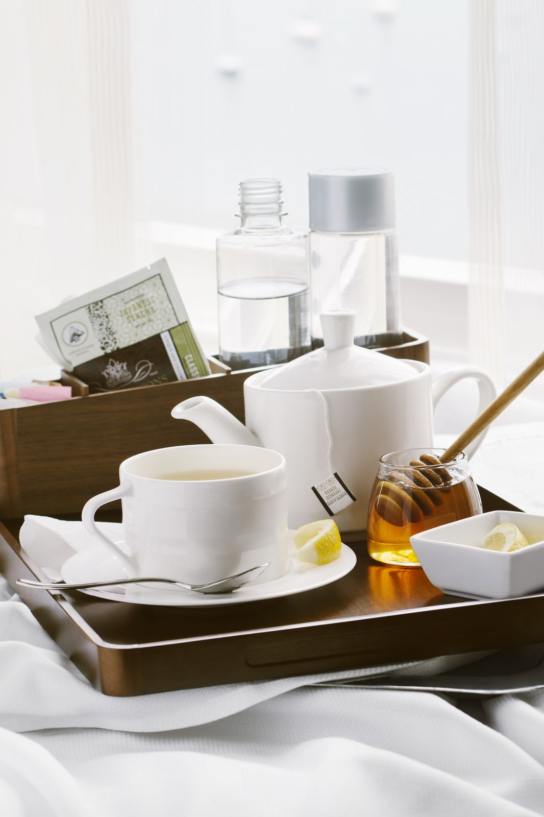 Tea and honey on a wooden serving tray