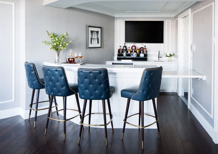 Four bar stools at bar with wall mounted TV