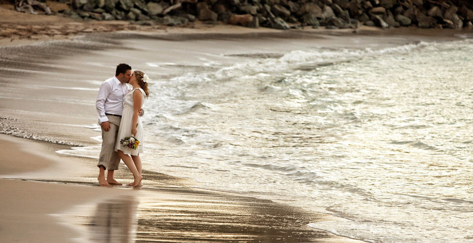Wedding couple kissing on Whistle Beach