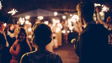 Wedding reception at night with sparklers