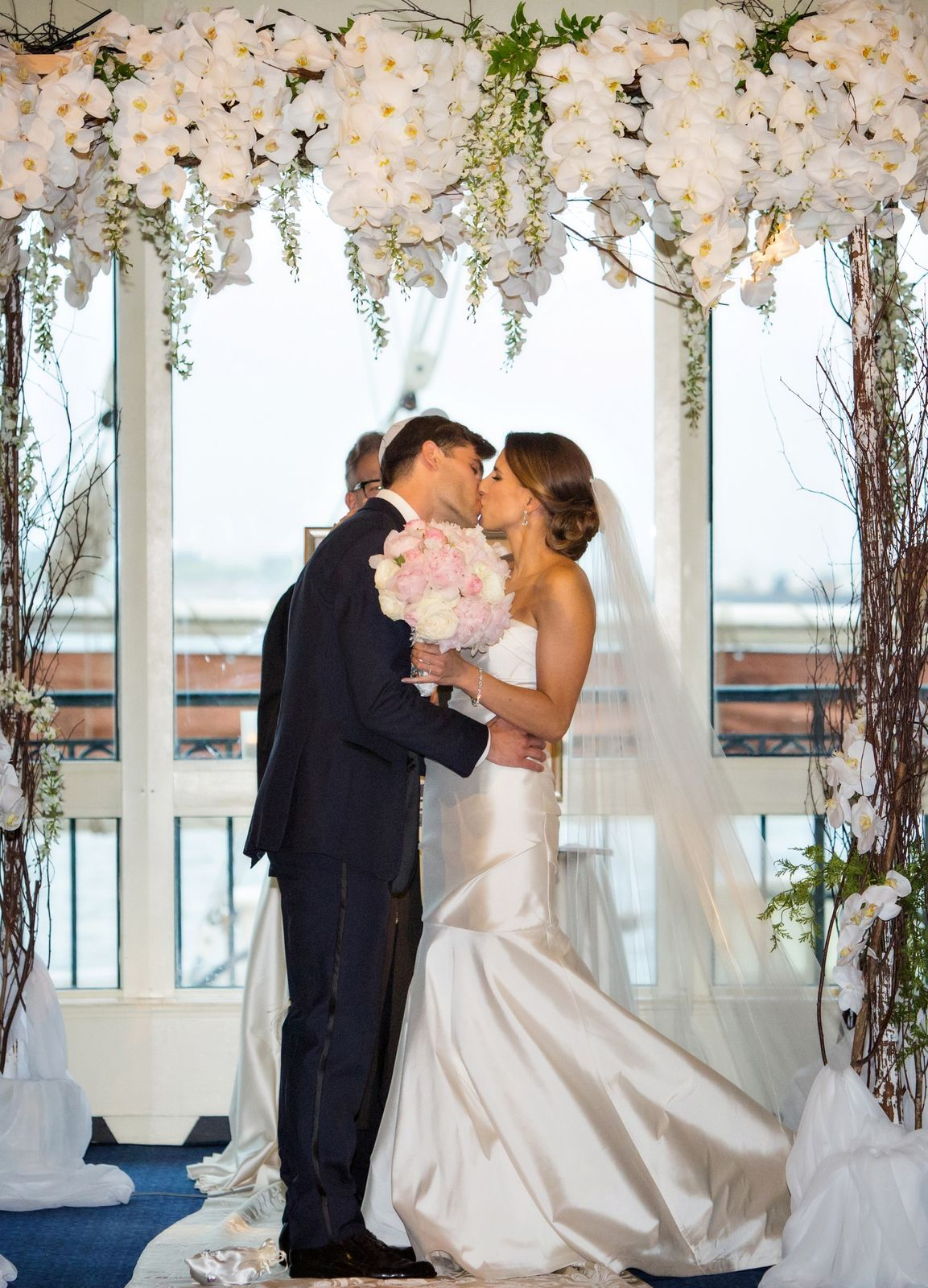 Newlyweds sharing their first kiss