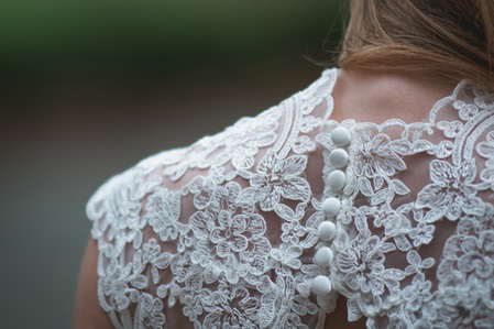 Close photo of shoulder and neck of wedding dress
