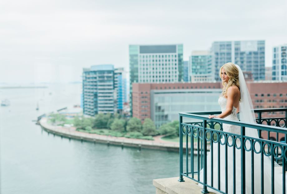 Bride on terrace overlooking Boston Harbor