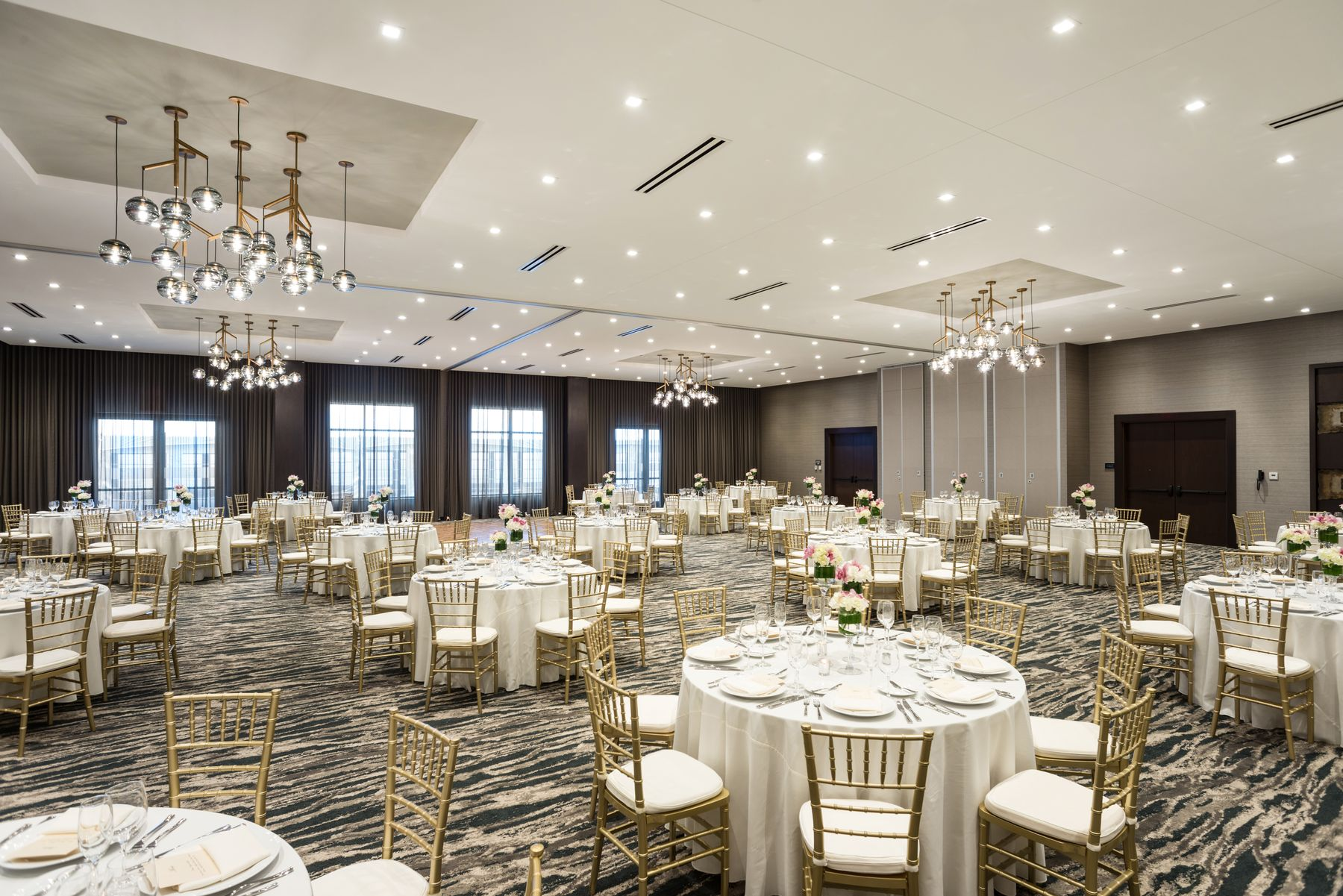 Event space set with banquet rounds