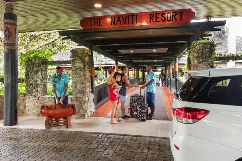 Welcome with Car in the foreground at Naviti Resort