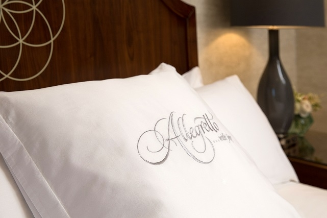 Headboard details and pillows with in the rooms at at Allegretto