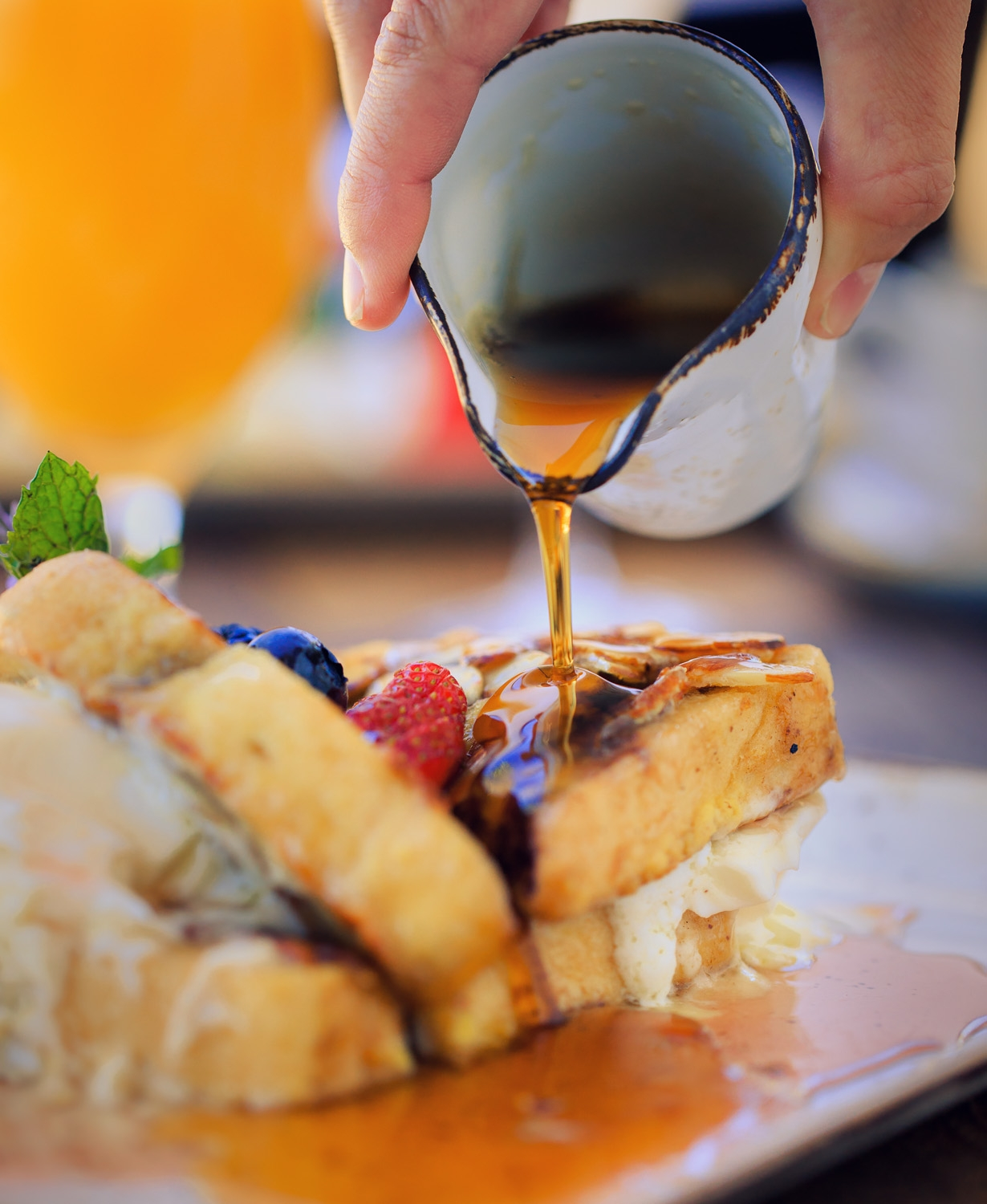 Cello Restaurant's french toast with syrup being poured over the