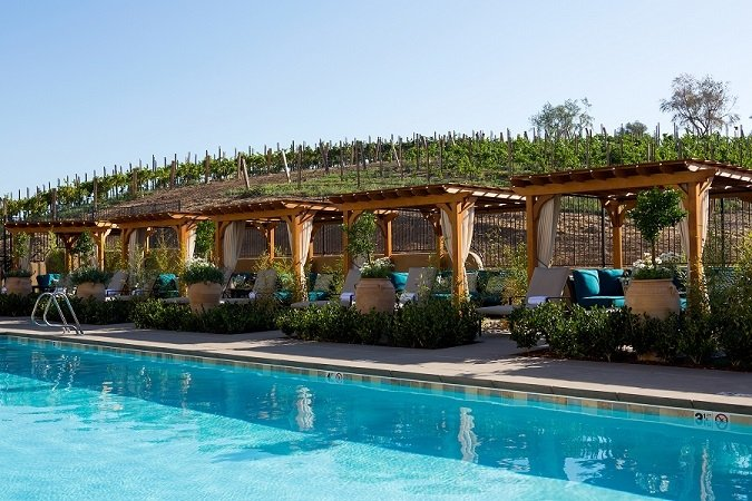 The pool and cabanas at Allegretto Vineyard Resort in Paso Roble