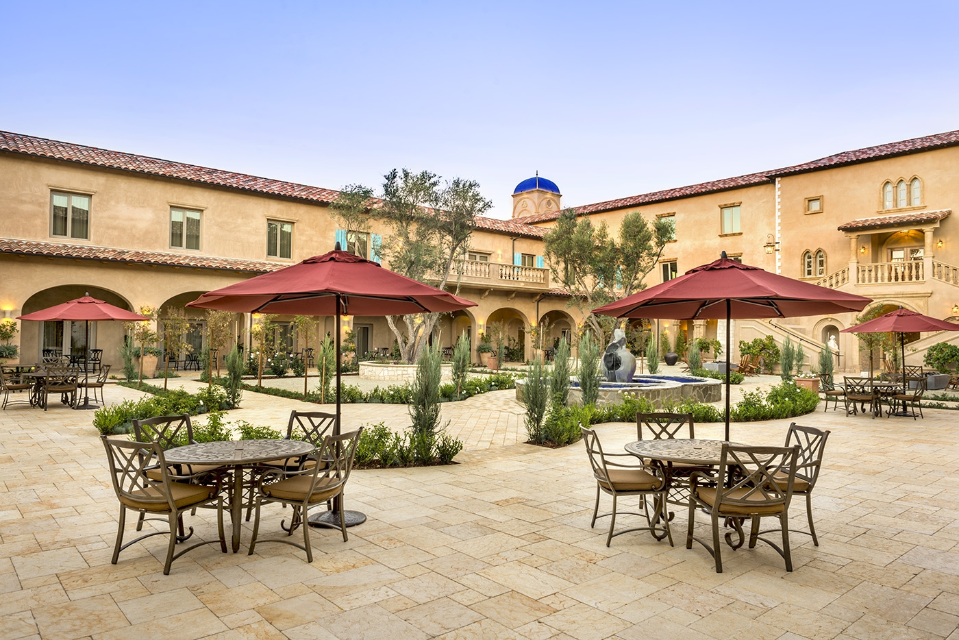 Courtyard at Allegretto Vineyard Resort with round table seating
