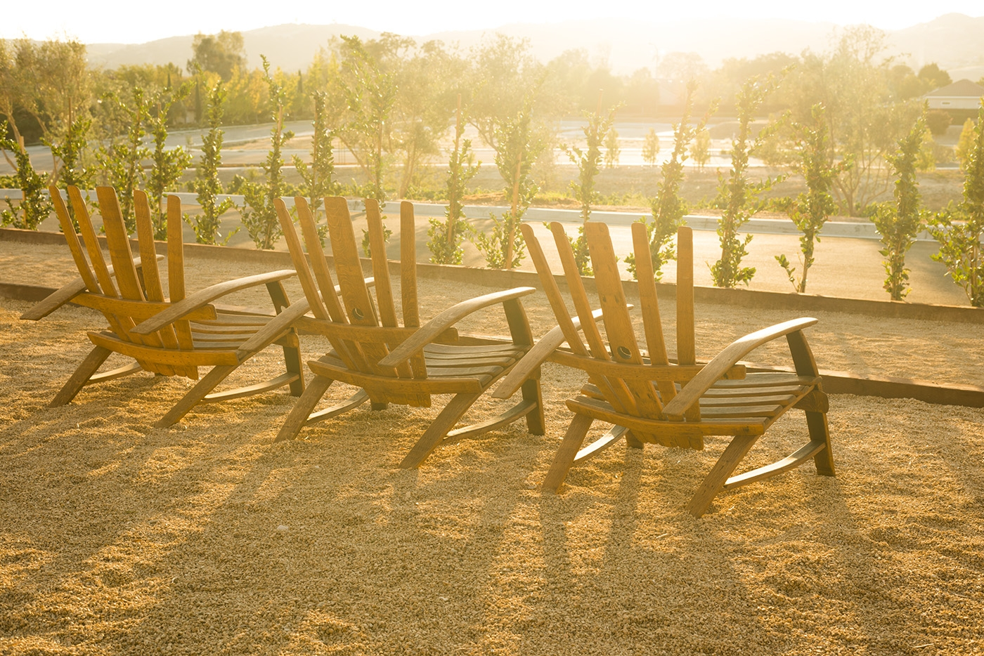 Lounge chairs looking over the bocce ball court with a setting s