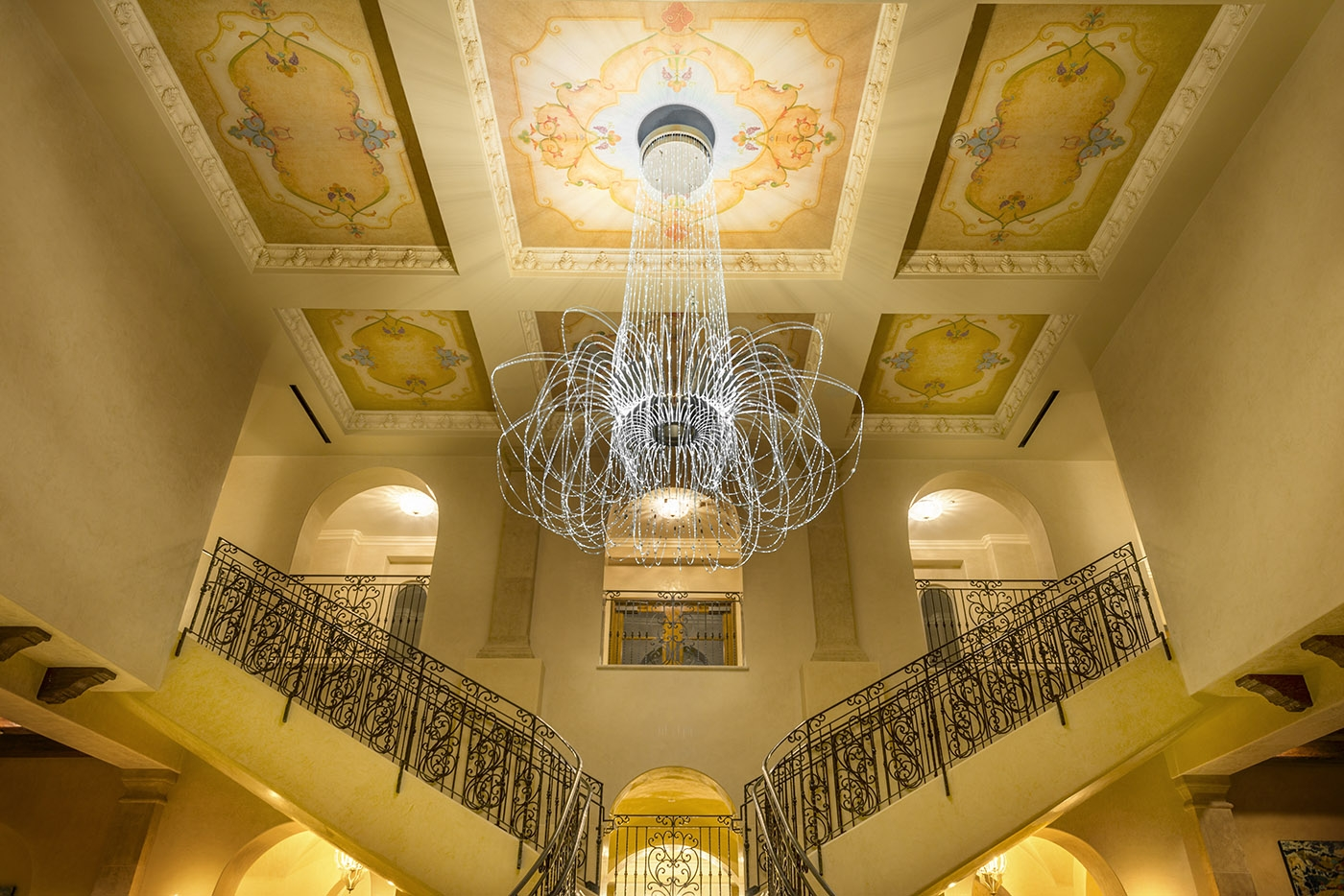 Allegretto's two story lobby with painted ceilings and split sta